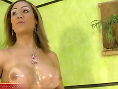 Mesmeric shemale with big tits oiling her awesome body