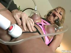 Appealing babe in bondage being screwed hardcore doggy style in BDSM seen