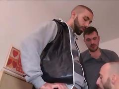 Two guys filling a slut.