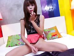 Cute shemale in the kinkiest dress reveals her gigantic erection