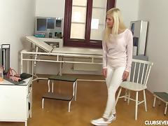 Cute golden-haired lass takes the realistic toy and plays with it