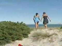 Young and mature lesbians peeing at the beach