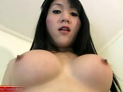 Cute Asian trans babe makes her cock hard with soft strokes