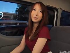 Banging the pussy of a Japanese brunette on the back seat of the car