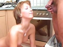 Redhead cougar with small tits pissed on in the kitchen