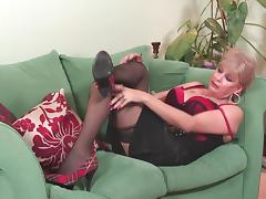 Older chick in a red dress and her love for the kinky glass toy