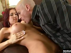 Redhead bombshell with big fake tits Kylee has her wet cunt drilled