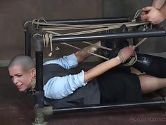 Bald slut simply enjoys being restrained in the dungeon