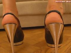 Screams from slave as foot fetish cowgirl pres him using high heels
