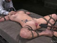 Tattooed slaved maiden in bondage moaning as her pussy is screwed using machine