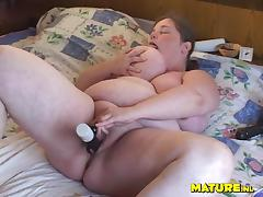 Mature Dutch babe with huge curves finally decides to use a black toy
