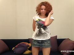 Seductive redhead with curly hair enjoys stretching her wet snatch