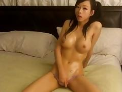 sexy asian plays with her pussy