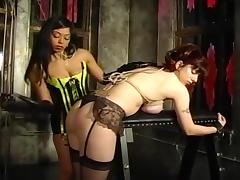 Asian Dominatrix Educates Busty Redhead