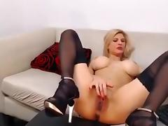 Sexy blonde slut on webcam stripteasing and masturbating hr pussy