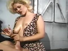 A Busty Blonde Gives A Firm Handjob