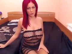 Sexy stripteasing redhead babe seducing on webcam with her sexy body