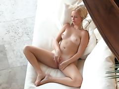 Pale blonde Megan knows how to make her pussy wet