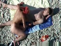 Busty nudist fucked at the beach