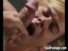 Two blonde guys in gay blowjob action