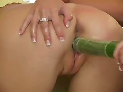Teen lesbians fill pussy with cucumber