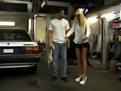 Mature blonde fucked in an auto repair shop