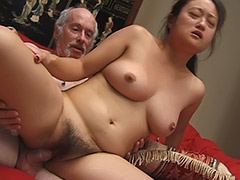 Asian Amateur with a very Big Bush is Being Used by an Old Man who Gives His Cock for Sucking and then Uses Condom to Fuck Her porn video