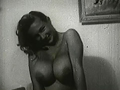 Busty Blonde Posing on Her Bed 1950 porn video