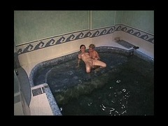 Two luscious babes Two luscious babes were lazily fondling each other in the swimming pool when thei