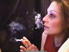 Webcam girl lights up a cigarette