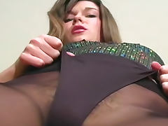 Sexy young beauty in erotic pantyhose tease