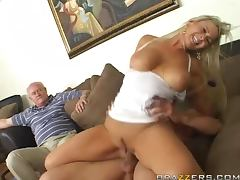 Busty blonde Abbey Brooks rides a cock in the presence of a voyeur