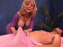 Busty Blonde Mature Nina Hartley Gives Guy a Massage and a Blowjob porn video