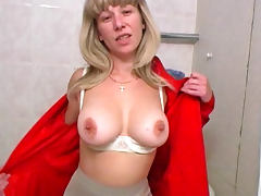 Milf pissing in the bathroom