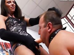 Beautiful mistress straps her male slave