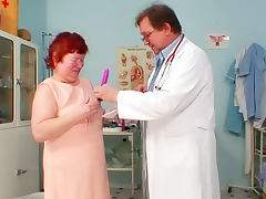 Mature redhead in gynecological exam