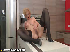 Horny older lady in sexy black stockings