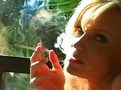 Blonde with big sexy tits smokes