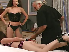 Lesbian domination with a paddling of the ass