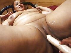Massaging fat ebony dildo session
