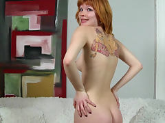 Tattooed ginger babe Mia Sollis shows her body