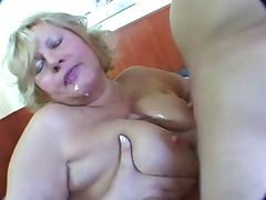 Fat blonde mature masturbation on bed