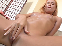 Slender blonde Elvira and her shaved sexy pussy