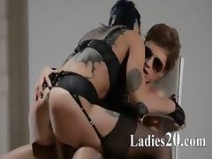 Tatto lezzs enjoying sex with strap on