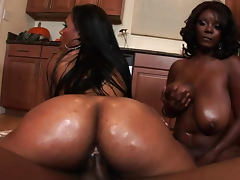 Two ebonies Stacey and Monique sharing one wiener