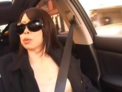 Hot and sexy Japanese babe rubbing her pussy in the car