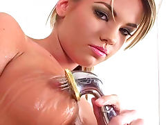 Glamour blonde Vicky Fast fucks herself with dildo