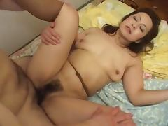 Japanese mature woman gets her hairy pussy fingered and fucked