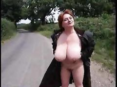 Busty mature bitch shows off her huge tits and plays with them