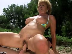 Slutty granny Effie has sex with a lifeguard on a beach